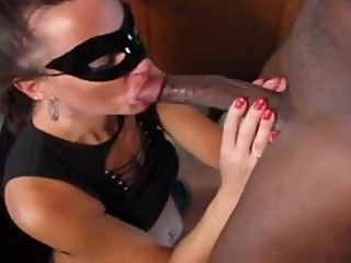 Masked cuckolding wife with black bull